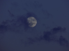 Clouds Puffing At Moon